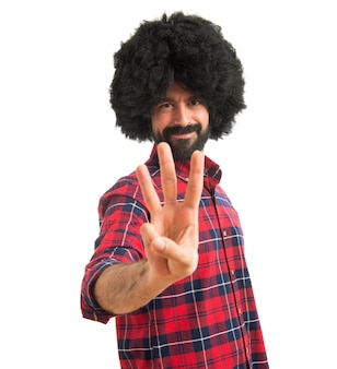 Afro man counting three