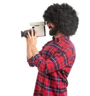 Afro man filming