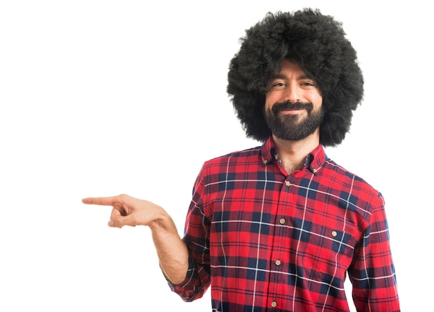 Afro man pointing to the lateral