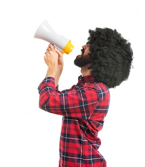 Afro man shouting by megaphone
