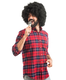 Afro man singing with microphone