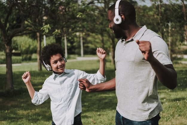Afro son and afro father listen music and dancing