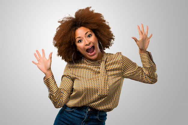 Afro woman being surprised
