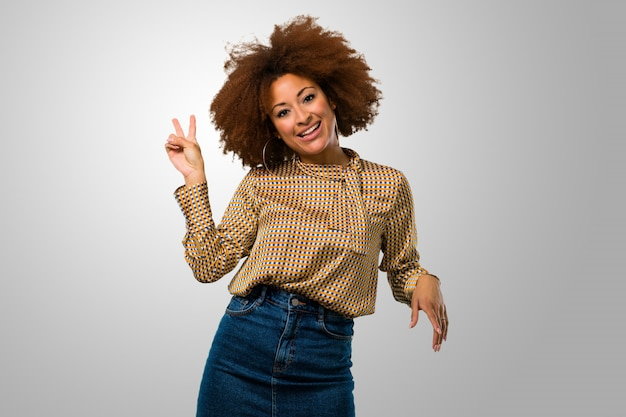 Afro woman doing a victory sign