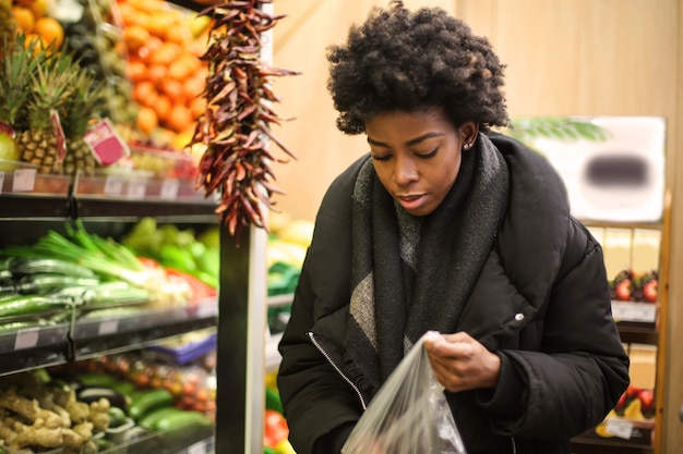Afro woman in a grocery store
