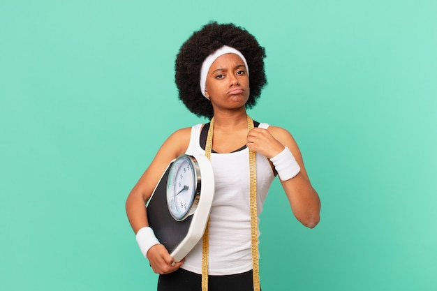 Afro woman looking arrogant, successful, positive and proud, pointing to self diet concept