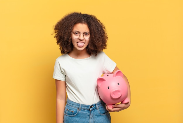 Afro woman looking puzzled and confused, biting lip with a nervous gesture, not knowing the answer to the problem. savings concept