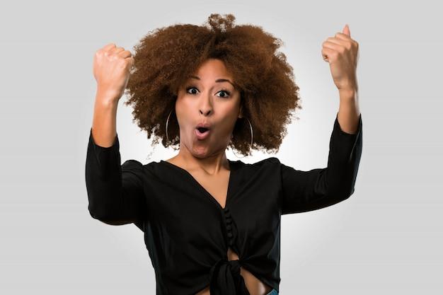 Afro woman winning, face closeup