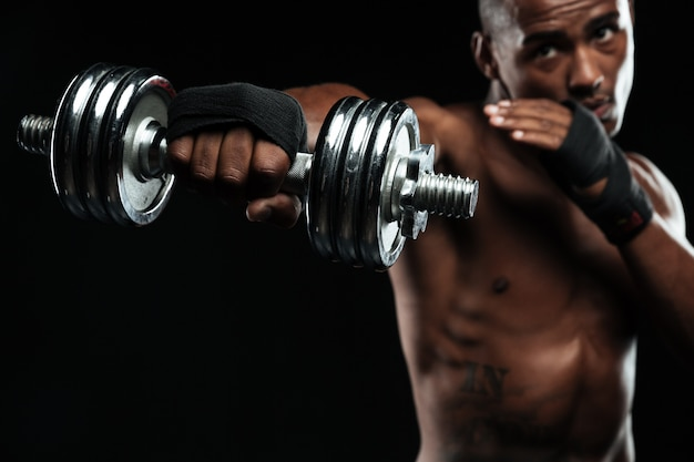 Afroamerican boxer training with dumbbells