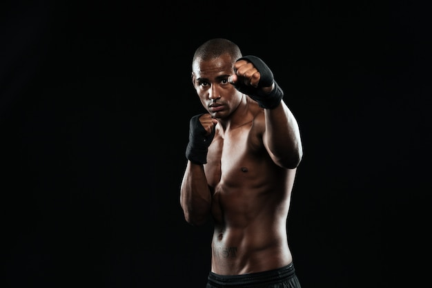 Afroamerican boxer with strong hands and clenched fists