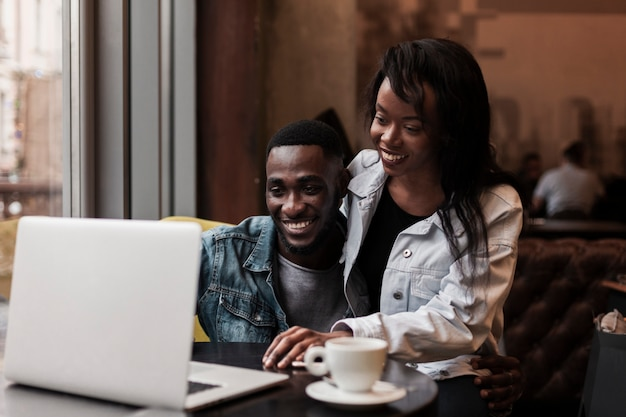 Afroamerican couple looking at laptop