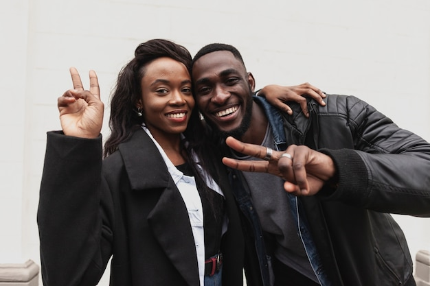 Afroamerican couple showing peace sign