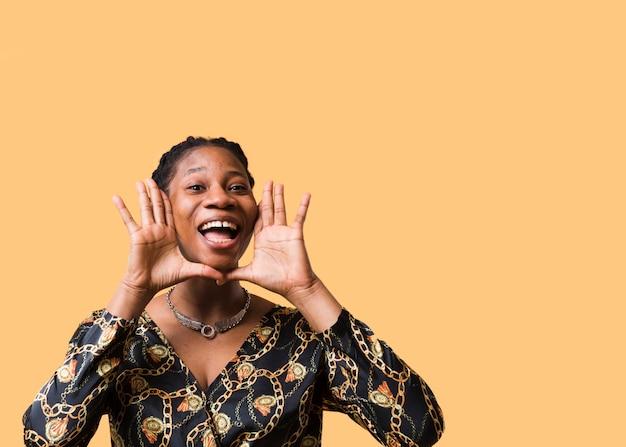 Afroamerican model shouting copy space
