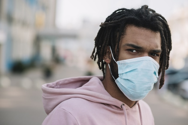 Afroamerican model wearing medical mask