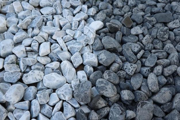 배경 대비 깨끗한 회색 검은 돌 전후