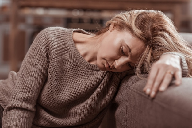 After divorce. close up of mature blonde-haired woman feeling awful after divorce with husband