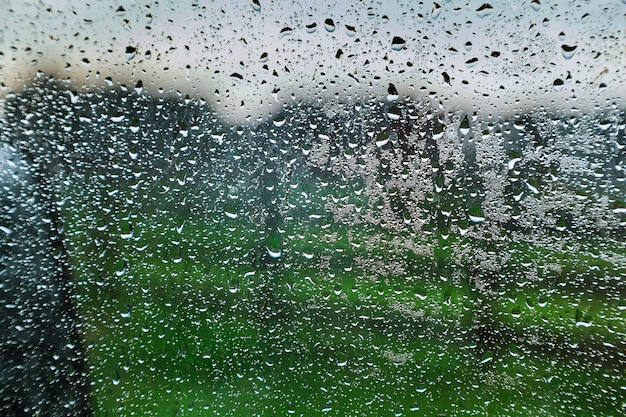 After rain water beads drizzling glass window of the resort.