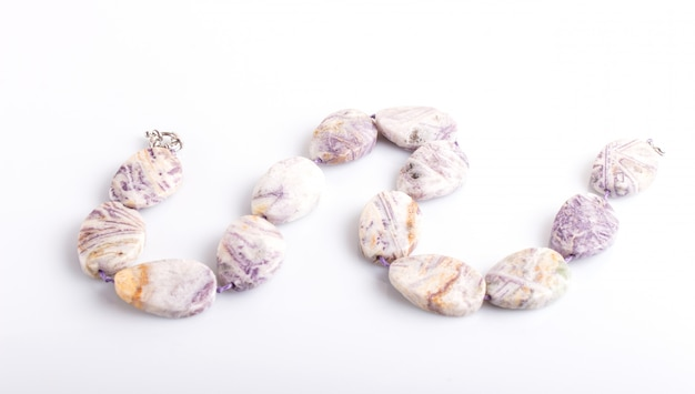 Agate colored beads isolated on white background