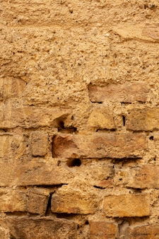 Aged brick wall with cement