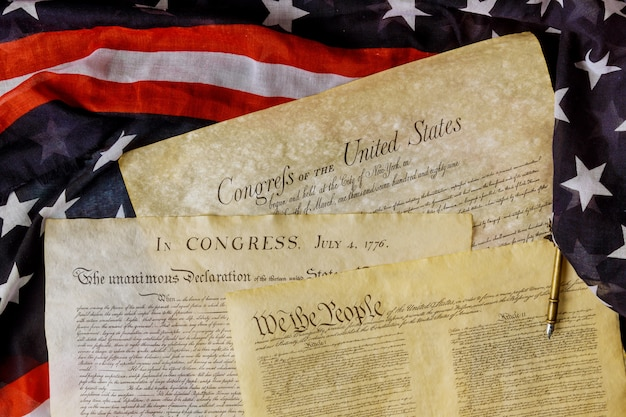Aged historical documents washington dc on american declaration of independence 4th july 1776 on usa flag