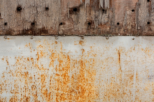 Aged metal with rust stains and chipping wood
