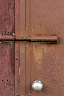 Aged metallic surface with rough wood and lock
