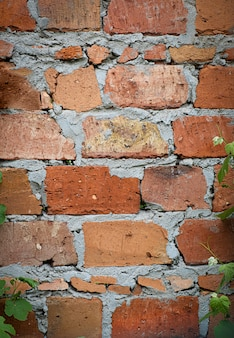 Aged red brick with concrete wall texture