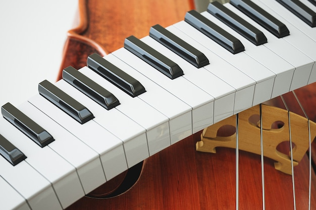 Aged violin and piaone keys concept. high quality 3d rendering