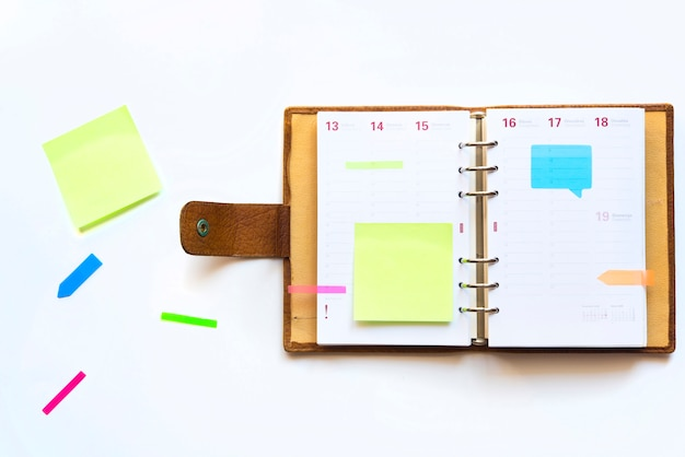 Agenda with colorful post it for reminders