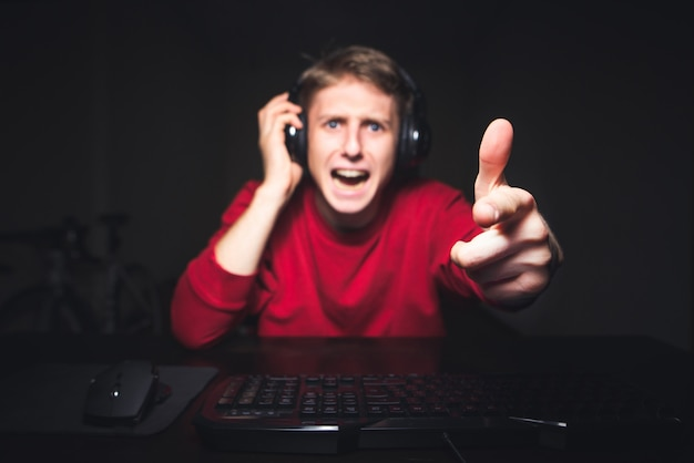 Aggressive gamer plays online games at home on a computer