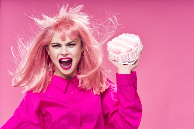 Aggressive woman rushes a cake