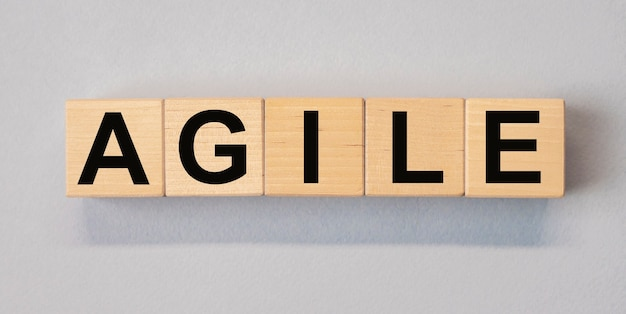 Agile word on wooden cube blocks on background