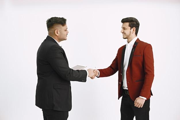Agreement between coworkers. two men having a deal.