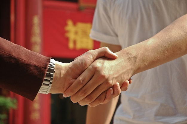 Agreement is reached by shaking hands of the rich and the poor