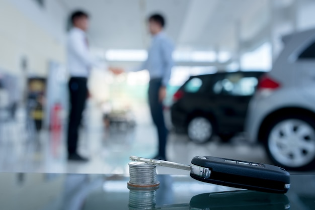 Agreements to buy new cars, new car loans or signing contracts with car keys and mone