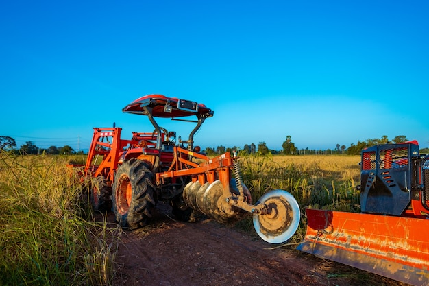 Agricultural machinery in the rice fields at sunset