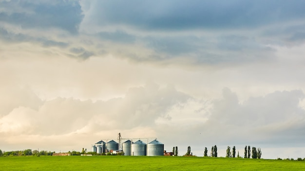 The agricultural silos on sunset after thunderstorm