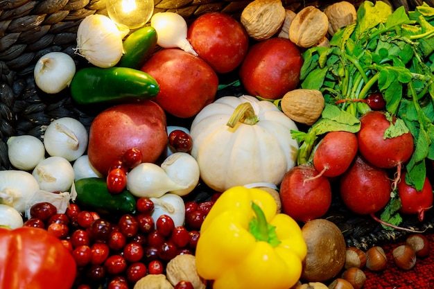 Agriculture harvested products on autumn background from fallen fruits