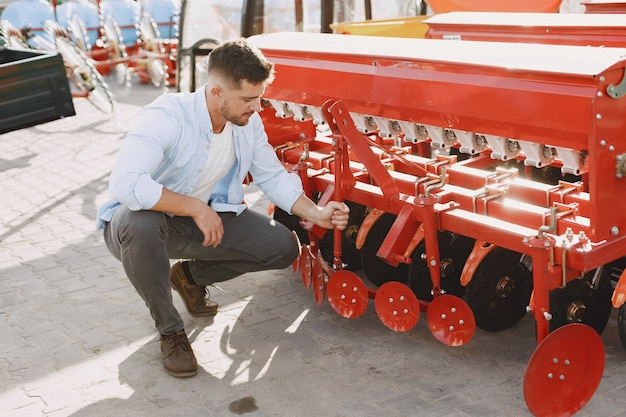 Agronomist choosing a new planter. man at the outdoor ground of the shop. agricultural machinery.