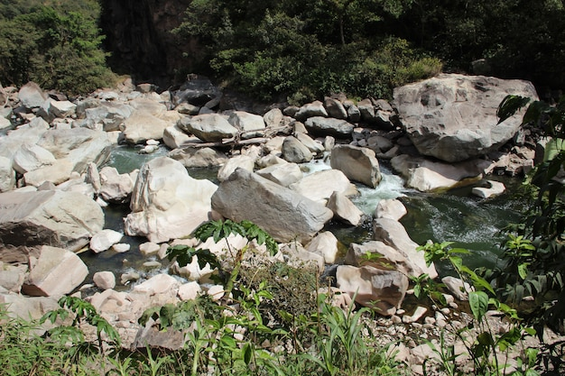 The aguas calientes river with stones. peru
