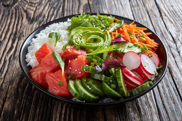 Ahi salmon poke bowl with rice, seaweed, veggies