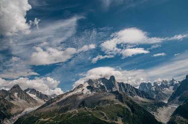 Aiguille verte with cloudy blue sky and glaciers and mountains