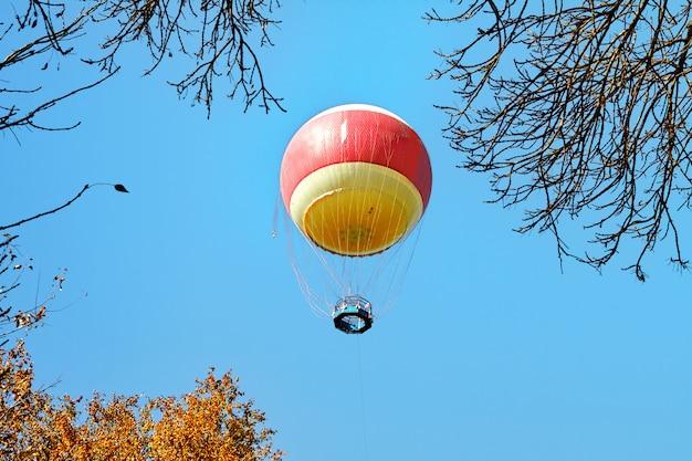 Air balloon in clouds over yarkon park , tel aviv