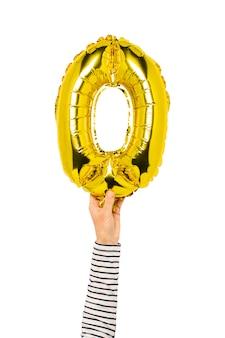 Воздушный шар номер ноль держит руку