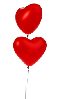 Air balloons. bunch of red heart shaped foil balloons