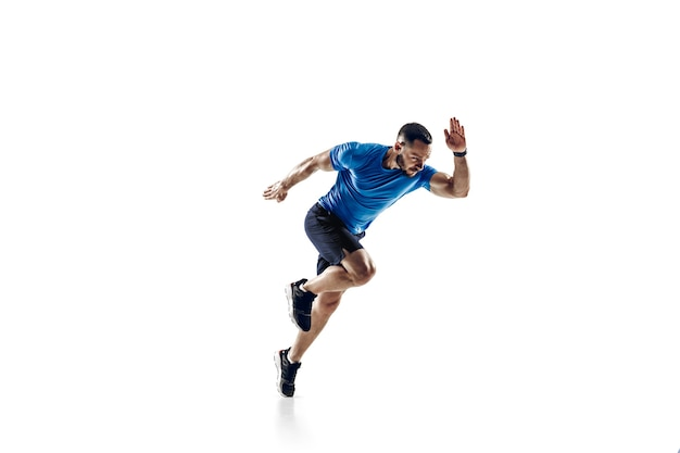 In air. caucasian professional male athlete, runner training isolated on white  background.