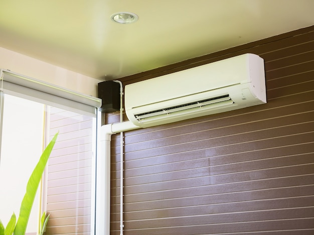 Air conditioner on the brown wall