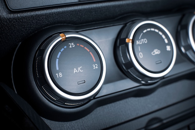Air conditioner button for temperature climate adjustment in a car.