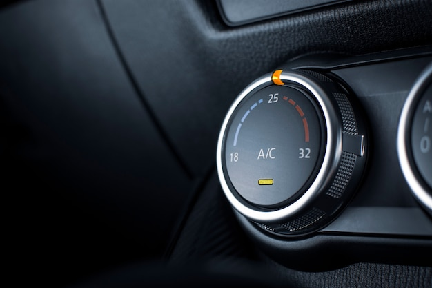 Air conditioner button for temperature climate adjustment in a car