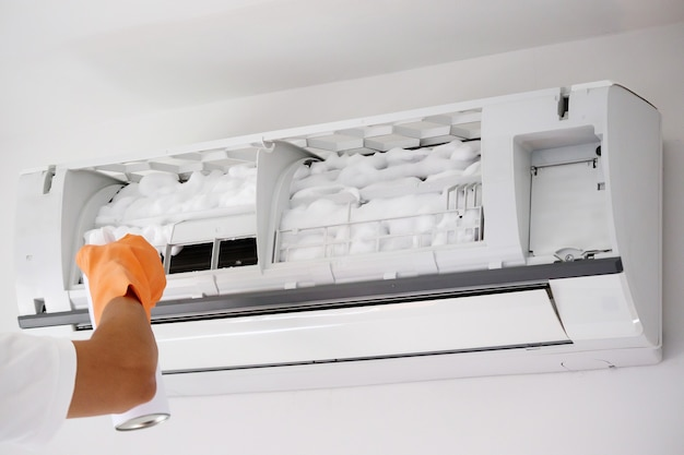 Air conditioner cleaning with spray foam cleaner